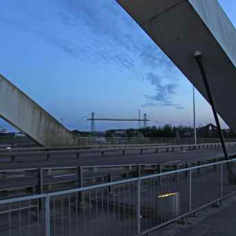 MB transporter bridge in distance wide